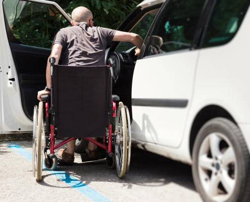 iStock 000056426418 male wheelchair entering car sm scaled