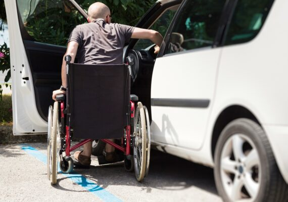 iStock_000056426418_male_wheelchair_entering car_sm